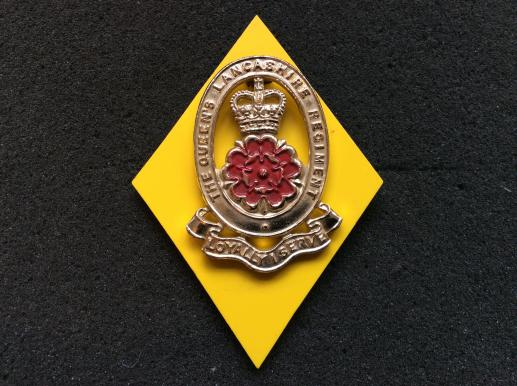 The Queens Lancashire Regiment Anodised Cap Badge, with backing